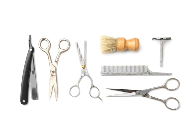 Vintage tools of barber shop on white surface