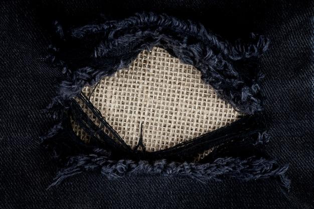 Vintage torn black jeans texture