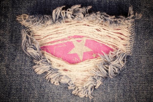 Vintage torn denim jeans texture