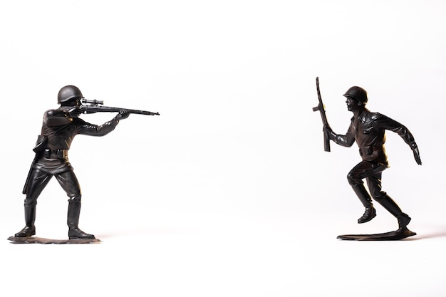 Vintage toy black soldiers isolated on white background.
