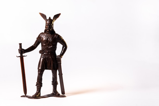 Vintage toy brown viking soldier isolated on white background.
