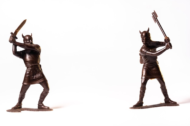Vintage toy brown viking soldiers isolated on white background.