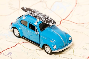 Vintage toy car on a map