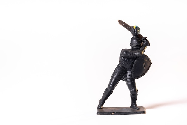 Vintage toys black soldier knight isolated on white background.