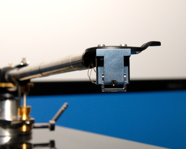 Vintage turntable closeup with a record playing