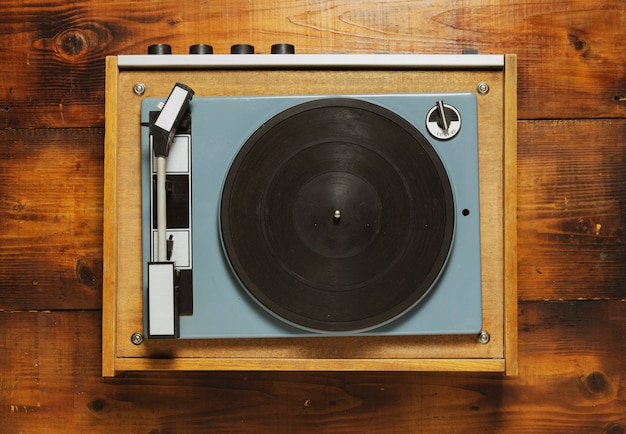 Vintage turntable vinyl record player on wood