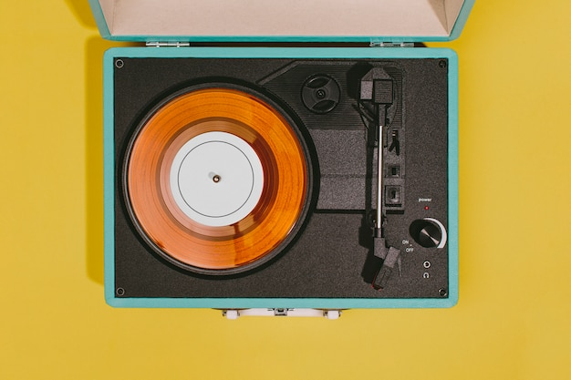 Vintage turntable with yellow surface