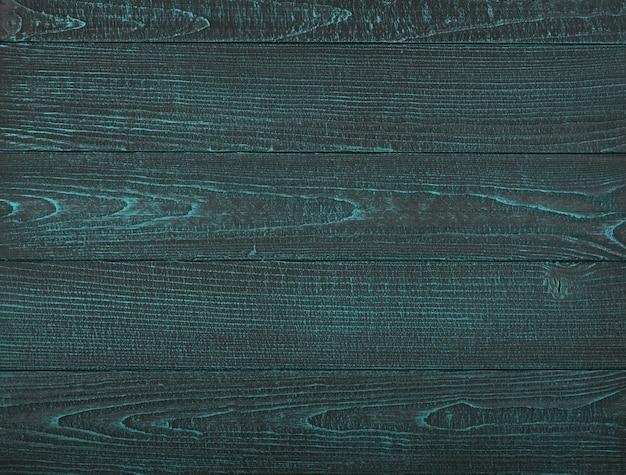 빈티지 청록색 나무 판자 배경 질감은 페인트로 칠해진 나무 표면에 긁힌 자국과 얼룩이 있습니다.
