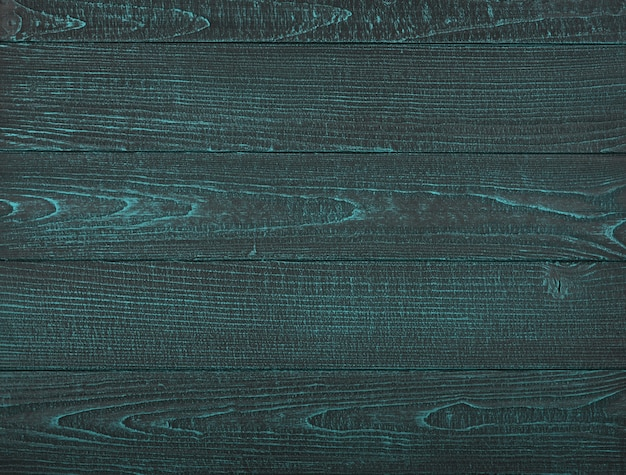 Vintage turquoise teal wooden planks background texture with scratches and stains over painted weathered wood surface