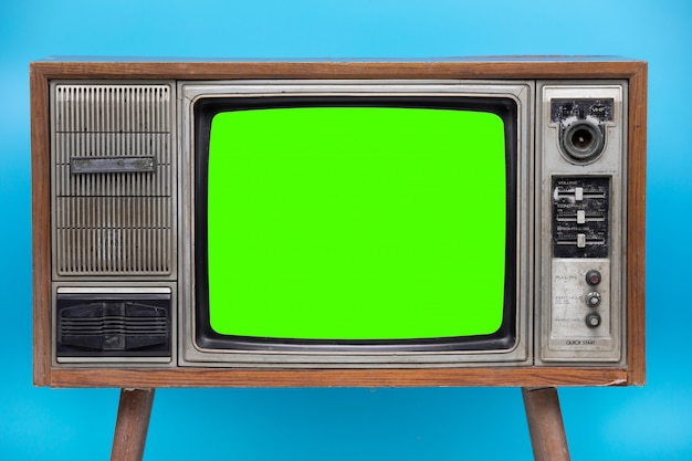 Vintage tv isolated on blue background .