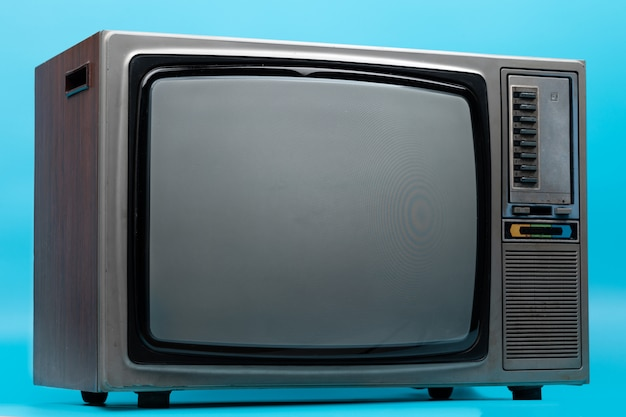 Vintage tv isolated on blue