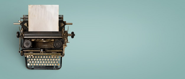 Vintage typewriter header with old paper