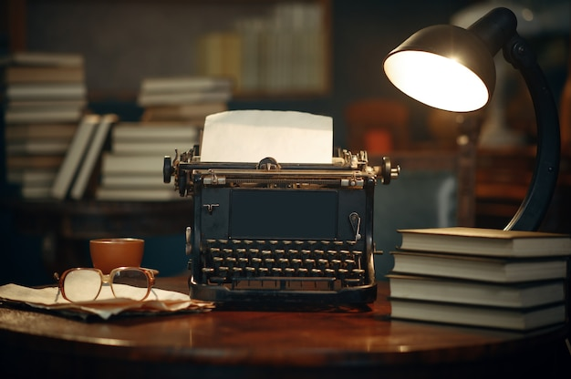 Vintage typewriter on wooden table in home office