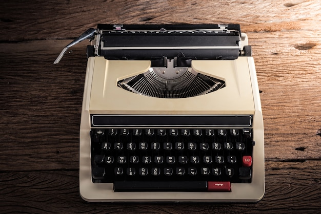 Vintage typewriter on wooden table, retro colors