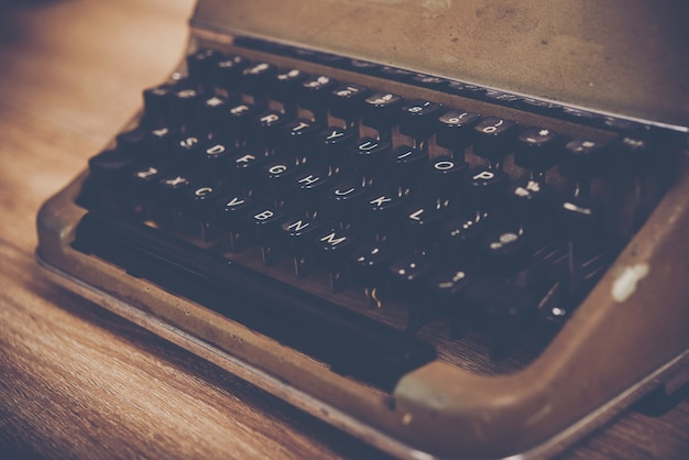 Vintage typewriter on wooden table.