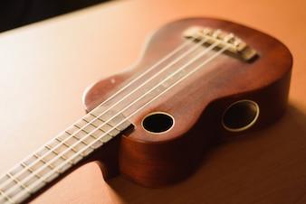 Vintage ukulele on wooden table