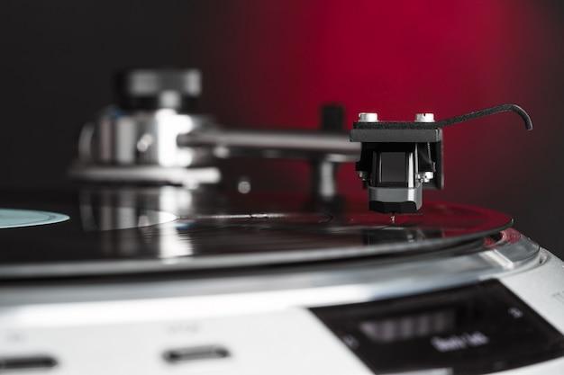 Vintage vinyl turntable in action closeup