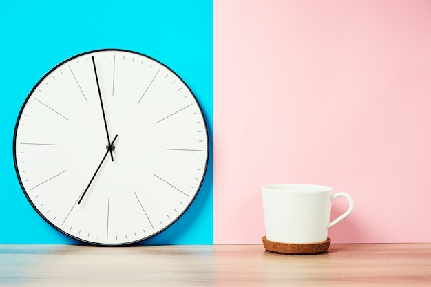 Vintage wall clock and cup of coffee