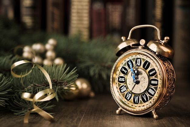 Vintage watch on a festive background showing five to midnight
