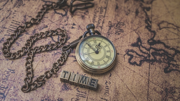 Vintage watch necklace on old world map