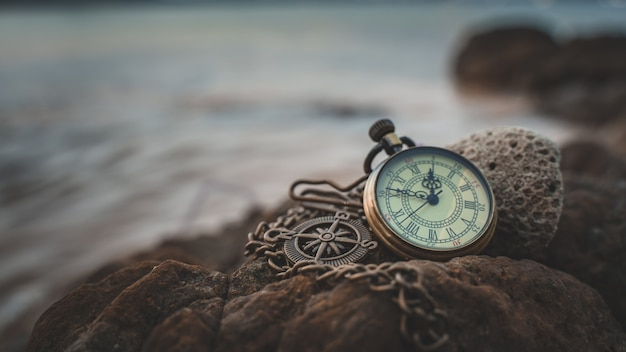 Vintage watch on sea stone