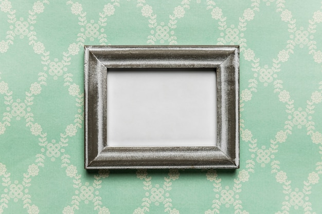 Vintage white frame with pattern background