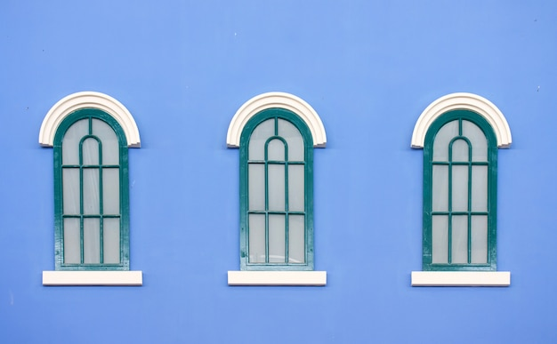 Vintage windows on blue wall