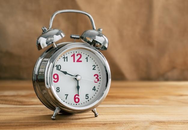 Vintage with retro alarm clock on table