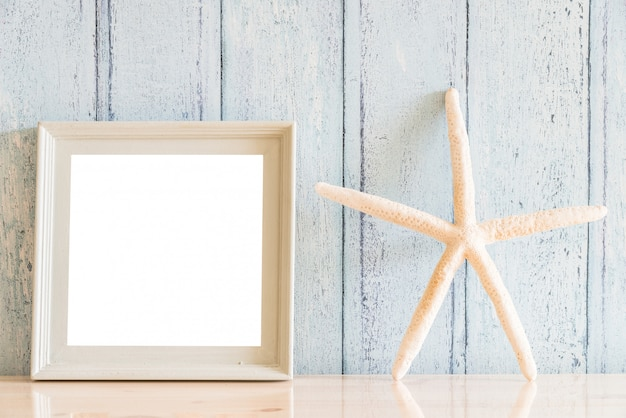 Vintage wood blank photo frame with summer concept