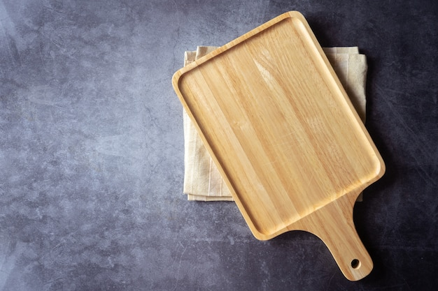 Vintage wood board with towel. kitchen cooking concept. space for text