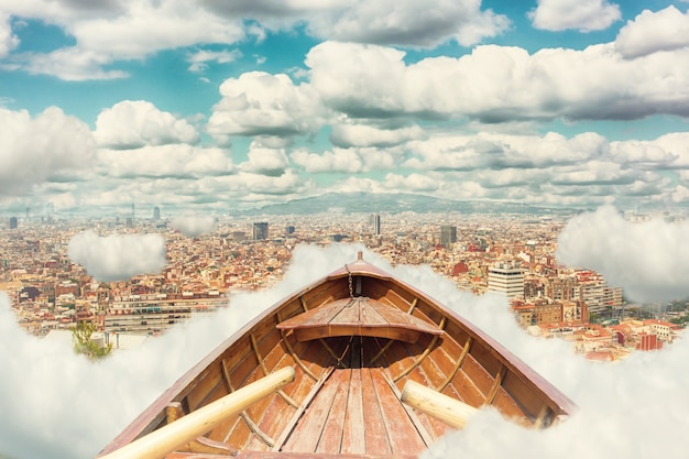 Vintage wooden boat in clouds