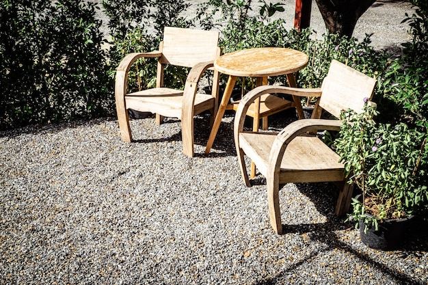 Vintage wooden chairs on backyard tropical garden