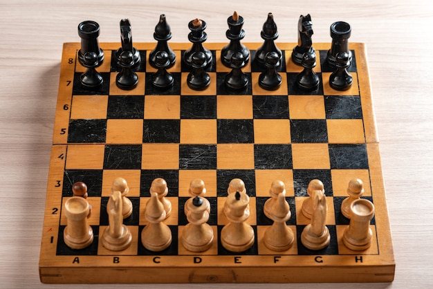 Vintage wooden chess board and figures