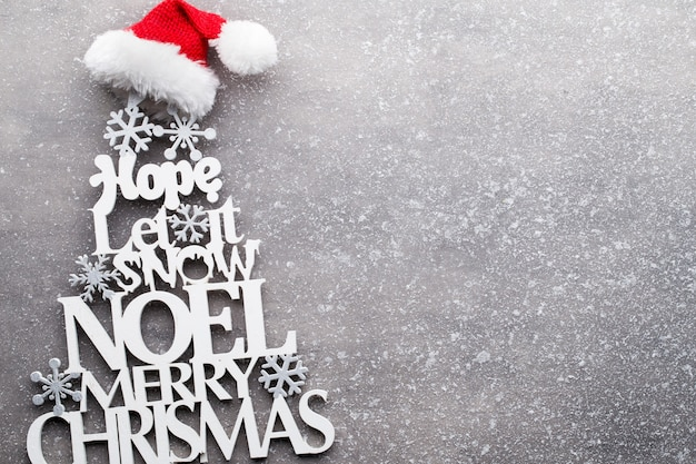 Vintage wooden christmas decor on the snow background.