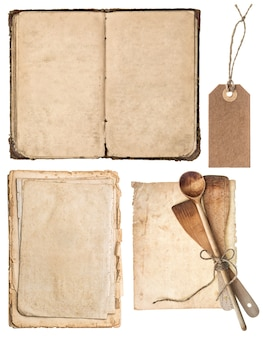 Vintage wooden kitchen utensils, old cookbook, pages and tag isolated on white background. grandma's recipes book concept