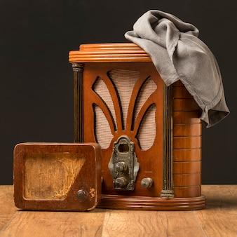 Vintage wooden radios and cloth