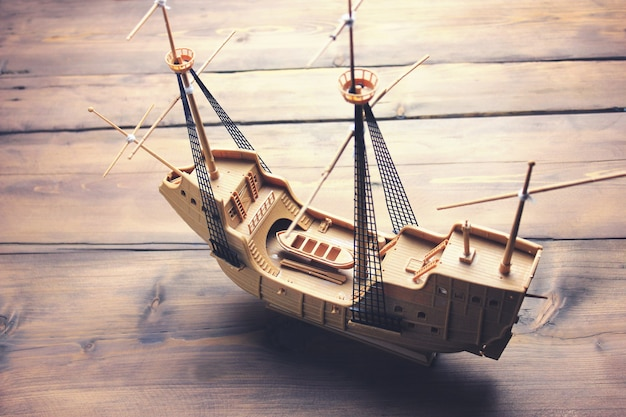 Vintage wooden  sailing boat on wooden table