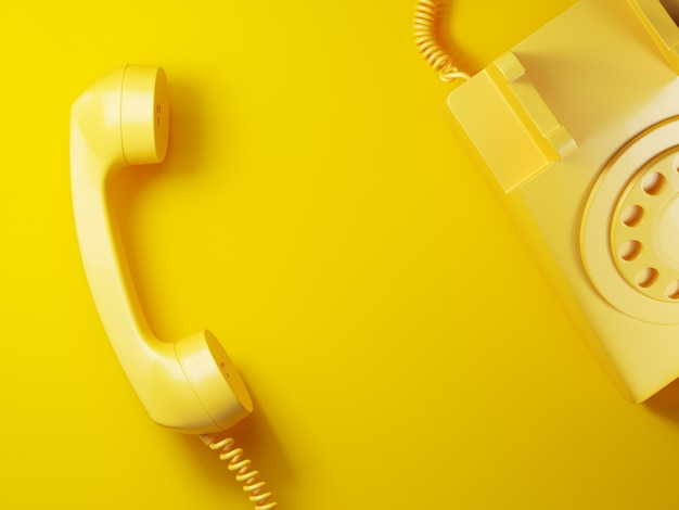 Vintage yellow phone receiver on yellow background 3d