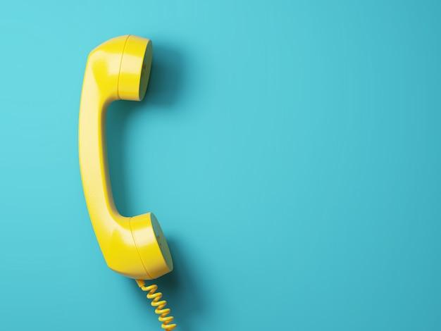 Vintage yellow telephone on aquamarine background 3d