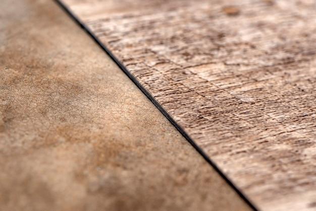 ビニール床、木のサンプル。小さな色のボード。黒のビニールの床の背景にコピースペースのあるデザインの画像