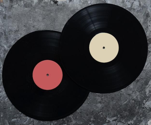 Vinyl plates on a gray concrete surface. retro technology. top view.