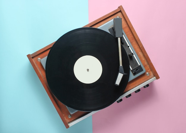 Vinyl player on blue pink pastel. top view