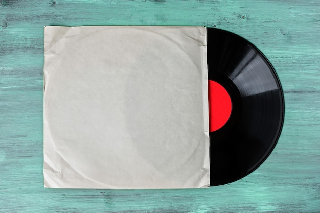 Vinyl record on green wooden table