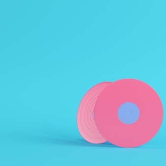 Vinyl records on bright blue background in pastel colors