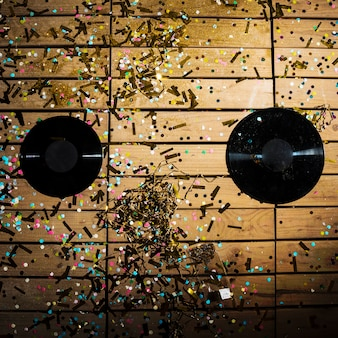 Vinyl records between bright confetti