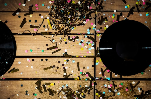 Vinyl records between colourful confetti
