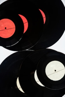 Vinyl records of different diameters on a white