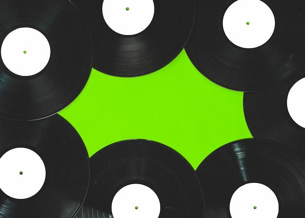 Vinyl records on green background