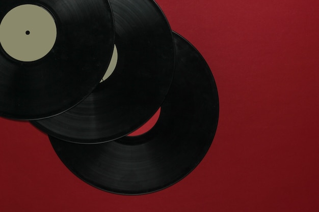 Vinyl records on a red background. top view