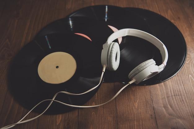 Vinyl records  and white headphones
